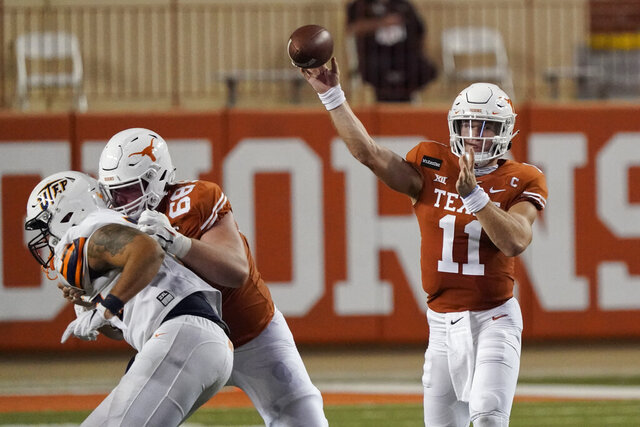 Texas' Sam Ehlinger (11) throws a pass against UTEP during the first half of an NCAA college football game in Austin, Texas, Saturday, Sept. 12, 2020. (AP Photo/Chuck Burton)
