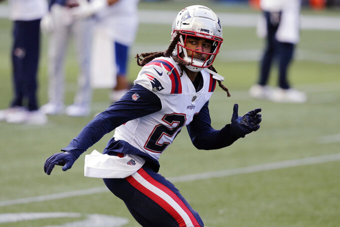 New England Patriots cornerback Stephon Gilmore warms up before an NFL football game against the Seattle Seahawks, Sunday, Sept. 20, 2020, in Seattle. For the second straight week the New England Patriots are heading into a game after having their preparations disrupted by a teammate contracting coronavirus. Last week it was Cam Newton. This week the Patriots' facility was closed for most of the week after reigning Defensive Player of the Year Stephon Gilmore joined Newton on the reserve/COVID-19 list. (AP Photo/John Froschauer, File)