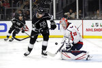 Washington Capitals goaltender Ilya Samsonov (30) stops a shot in front of Los Angeles Kings' Dustin Brown (23) during the second period of an NHL hockey game Wednesday, Dec. 4, 2019, in Los Angeles. (AP Photo/Marcio Jose Sanchez)