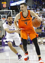 TCU guard Alex Robinson (25) defends Oklahoma State guard Thomas Dziagwa (4) during the first half of an NCAA college basketball game, Wednesday, Feb. 6, 2018 in Fort Worth, Texas. (David Kent/Star-Telegram via AP)