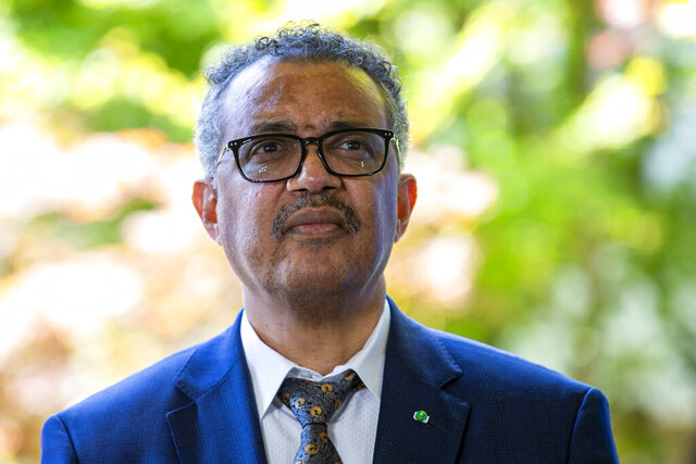 """FILE - In this Thursday, June 25, 2020 file photo, Tedros Adhanom Ghebreyesus, Director General of the World Health Organization (WHO), attends a press conference, at the (WHO) headquarters in Geneva, Switzerland. Ethiopia's government is accusing the head of the World Health Organization, a fellow Ethiopian, of lobbying neighboring countries to come to the aid of the country's rebellious Tigray regional government with arms and other support. Ethiopia's army chief asserts to reporters that Tedros Adhanom Ghebreyesus had urged unnamed neighbors to """"oppose the war and for (the Tigray People's Liberation Front) to get arms."""" (Salvatore Di Nolfi/Keystone via AP, File)"""