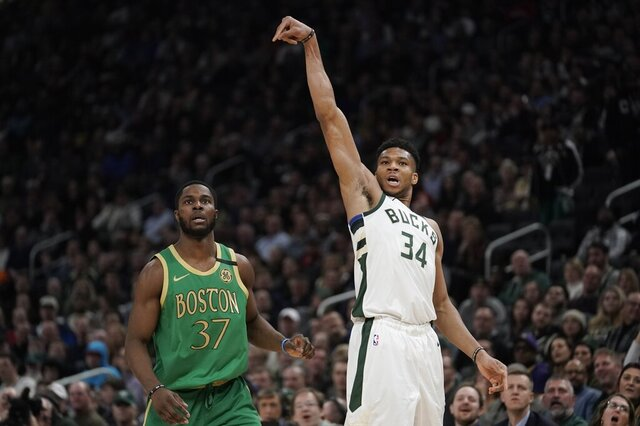 Milwaukee Bucks' Giannis Antetokounmpo shoots a three-point asket during the first half of an NBA basketball game against the Boston Celtics Thursday, Jan. 16, 2020, in Milwaukee. (AP Photo/Morry Gash)