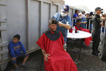 A Central American immigrant gets a haircut at a shelter in Piedras Negras, Mexico, Tuesday, Feb. 5, 2019. A caravan of about 1,600 Central American migrants camped Tuesday in the Mexican border city of Piedras Negras, just west of Eagle Pass, Texas. The governor of the northern state of Coahuila described the migrants as