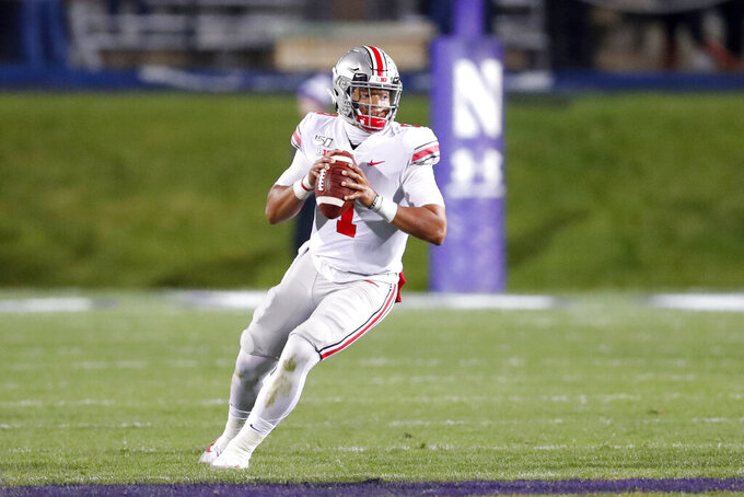 Ohio State quarterback Justin Fields drops back to pass during the first half of an NCAA college football game against Northwestern, Friday, Oct. 18, 2019, in Evanston, Ill. (AP Photo/Charles Rex Arbogast)