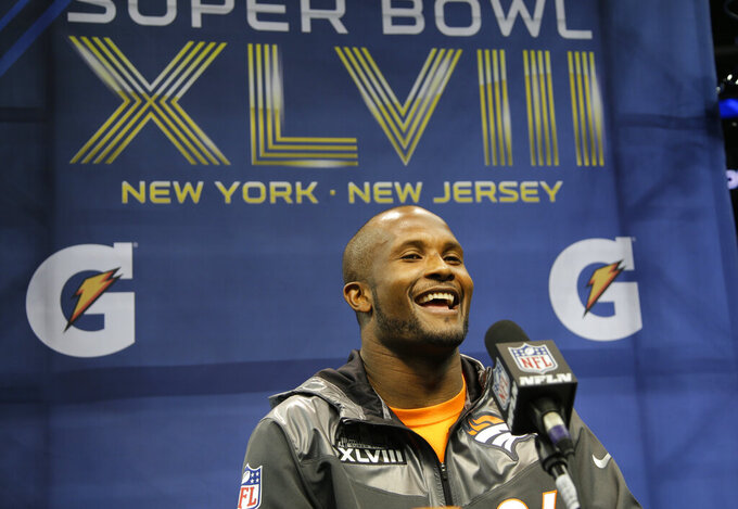 FILE - In this Jan. 28, 2014, file photo, Denver Broncos' Champ Bailey answers a question during media day for the NFL Super Bowl XLVIII football game in Newark, N.J. Bailey will be inducted into the Pro Football Hall of Fame in Canton, Ohio on Aug. 3, 2019. (AP Photo/Matt Slocum, File)