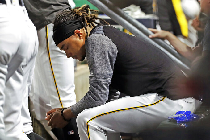 FILE - In this May 22, 2019, file photo, Pittsburgh Pirates starting pitcher Chris Archer sits in the dugout during the bottom of the ninth inning of a baseball game on the way to losing to the Colorado Rockies in Pittsburgh. Major League Baseball's average salary as opening day approached remained virtually flat at around $4.4 million for the fifth straight season, according to a study of contracts by The Associated Press. (AP Photo/Gene J. Puskar, File)