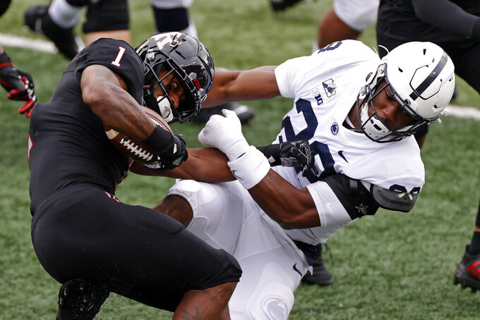 Penn State defensive end Jayson Oweh (28) tackles Rutgers running back Isaih Pacheco (1) during the first half of an NCAA college football game Saturday, Dec. 5, 2020, in Piscataway, N.J. (AP Photo/Adam Hunger)