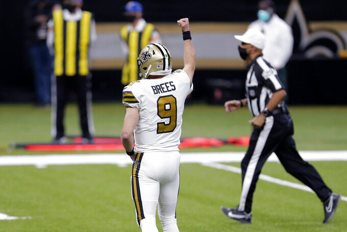 New Orleans Saints quarterback Drew Brees (9) celebrates a touchdown by running back Alvin Kamara in the first half of an NFL football game against the Minnesota Vikings in New Orleans, Friday, Dec. 25, 2020. (AP Photo/Brett Duke)