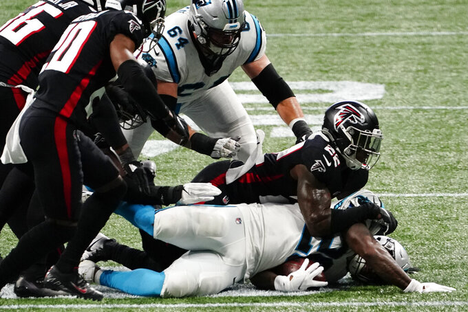 Carolina Panthers running back Mike Davis (28) is hit by Atlanta Falcons strong safety Keanu Neal (22) during the first half of an NFL football game, Sunday, Oct. 11, 2020, in Atlanta. (AP Photo/Brynn Anderson)