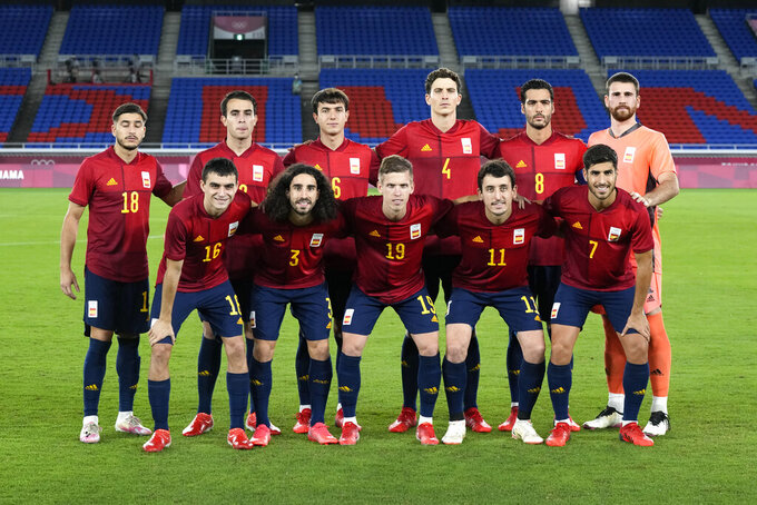 Spain's team poses for a photo prior to the men's final soccer match against Brazil at the 2020 Summer Olympics, Saturday, Aug. 7, 2021, in Yokohama, Japan. (AP Photo/Andre Penner)