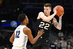 Butler forward Sean McDermott (22) handles the ball next to Georgetown guard Terrell Allen (12) during the first half of an NCAA college basketball game, Tuesday, Jan. 28, 2020, in Washington. (AP Photo/Nick Wass)