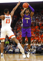 James Madison guard Matt Lewis (1) shoots next to Virginia guard Casey Morsell (13) during an NCAA college basketball game in Charlottesville, Va., Sunday, Nov. 10, 2019. (AP Photo/Andrew Shurtleff)