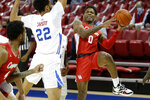 Houston guard Marcus Sasser (0) attempts a shot around the defense of SMU forward Isiah Jasey (22) during the first half of an NCAA college basketball game in Dallas, Sunday, Jan. 3, 2021. (AP Photo/Roger Steinman)