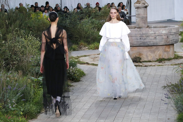 Models wear creations for the Chanel Haute Couture Spring/Summer 2020 fashion collection presented Tuesday Jan. 21, 2020 in Paris. (AP Photo/Francois Mori)
