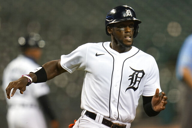 Detroit Tigers' Cameron Maybin scores on a Austin Romine double in the sixth inning of a baseball game against the Chicago Cubs in Detroit, Wednesday, Aug. 26, 2020. (AP Photo/Paul Sancya)