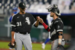 Chicago White Sox relief pitcher Steve Cishek (31) and catcher Yasmani Grandal, right, fist-bump following a baseball game against the Kansas City Royals at Kauffman Stadium in Kansas City, Mo., Thursday, Sept. 3, 2020. (AP Photo/Orlin Wagner)