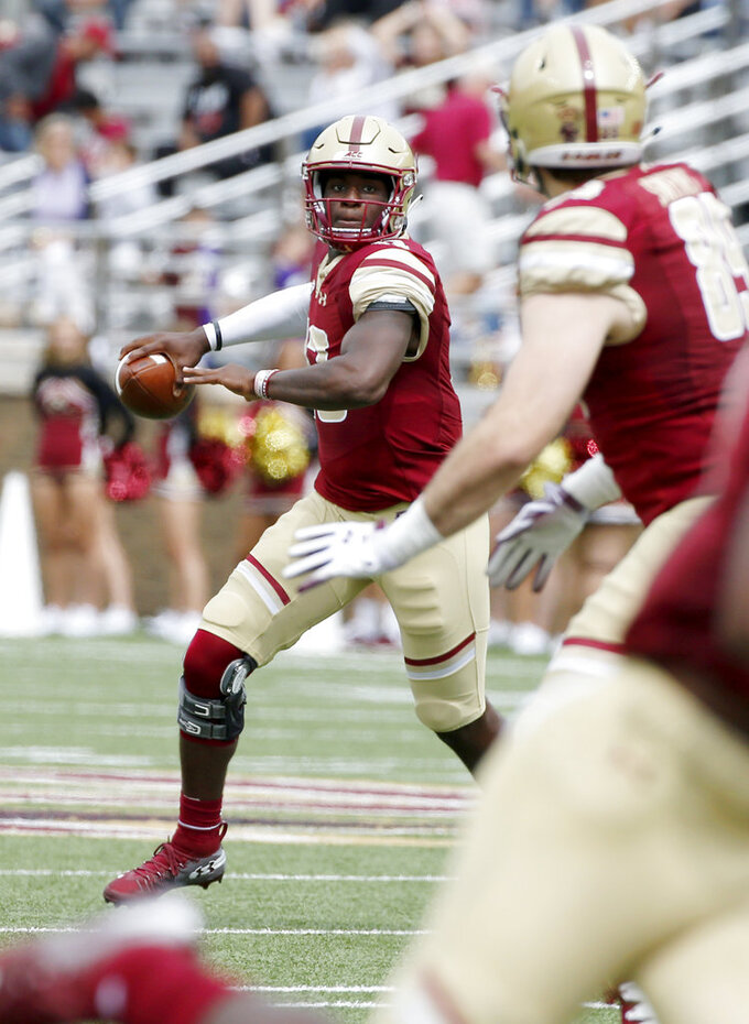 Boston College quarterback Anthony Brown (13) scrambles as he looks to pass during the first half of an NCAA college football game against Holy Cross, Saturday, Sept. 8, 2018, in Boston. (AP Photo/Mary Schwalm)