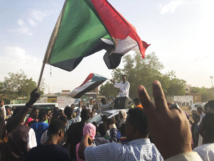 Sudanese people celebrate in the streets of Khartoum after ruling generals and protest leaders announced they have reached an agreement on the disputed issue of a new governing body on Friday, July 5, 2019.   The deal raised hopes it will end a three-month political crisis that paralyzed the country and led to a violent crackdown that killed scores of protesters.  (AP Photo)