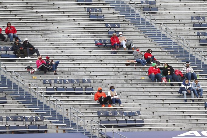 Louisville fans sit socially distant during an NCAA college football game Saturday, Nov. 14, 2020, in Charlottesville, Va. (Erin Edgerton/The Daily Progress via AP)