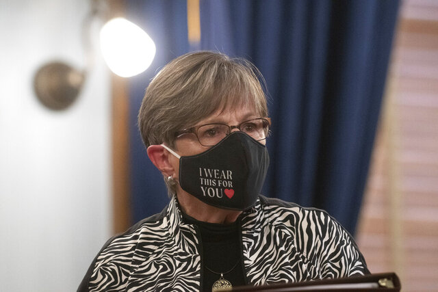 Gov. Laura Kelly wears a mask during a press conference Monday, July 20, 2020. Gov. Kelly signed an executive order Monday that mandates the use of masks in schools, daily temperature checks and hand sanitizer in each classroom. (Evert Nelson/The Topeka Capital-Journal via AP)