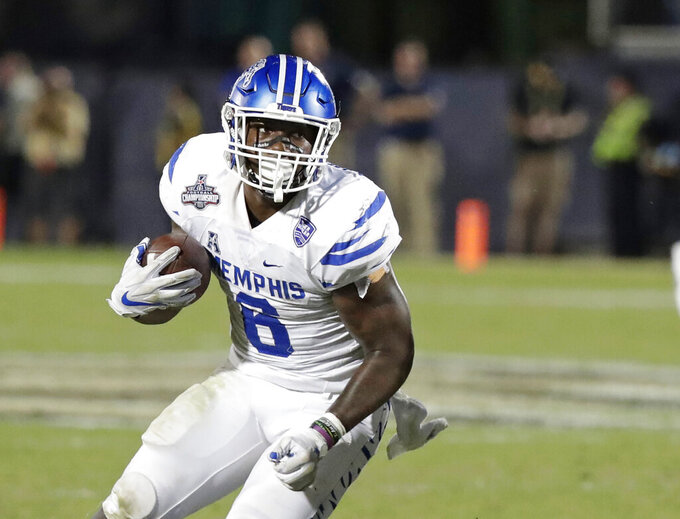 FILE -- In this Dec. 1, 2018, file photo, Memphis running back Patrick Taylor Jr. carries against Central Florida during the American Athletic Conference championship NCAA college football game in Orlando, Fla. Taylor's presence has Memphis confident it can improve upon last year's 8-6 season even as it replaces Darrell Henderson, the nation's second-leading rusher in 2018. (AP Photo/John Raoux, File)