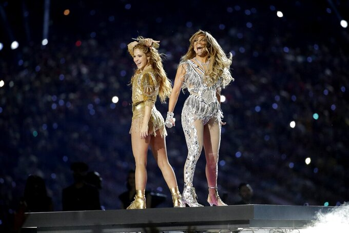 FILE - Shakira, left, and Jennifer Lopez perform during halftime of the NFL Super Bowl 54 football game between the Kansas City Chiefs and the San Francisco 49ers in Miami Gardens, Fla. on  Feb. 2, 2020. Lopez and Shakira's show-stopping Super Bowl halftime performance is nominated for four Emmy Awards. (AP Photo/Patrick Semansky, File)