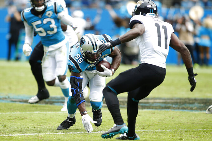 Carolina Panthers defensive end Marquis Haynes (98) recovers a fumble as Jacksonville Jaguars wide receiver Marqise Lee (11) looks to tackle during the second half of an NFL football game in Charlotte, N.C., Sunday, Oct. 6, 2019. (AP Photo/Brian Blanco)
