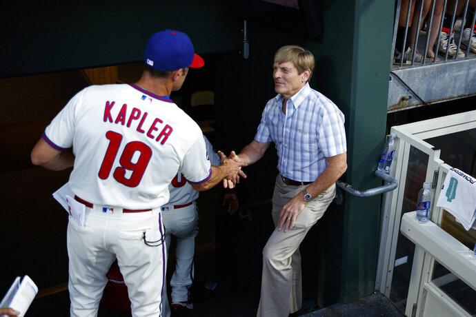 Philadelphia Phillies principle owner John S. Middleton, right, greets manager Gabe Kapler after a baseball game against the Miami Marlins, Sunday, Sept. 29, 2019, in Philadelphia. (AP Photo/Matt Slocum)