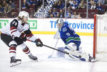 Vancouver Canucks goalie Jacob Markstrom, right, of Sweden, stops Arizona Coyotes' Mario Kempe, of Sweden, during the first period of an NHL hockey game Thursday, Feb. 21, 2019, in Vancouver, British Columbia. (Darryl Dyck/The Canadian Press via AP)