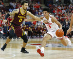 Ohio State's D.J. Carton, right, brings the ball up court as Minnesota's Payton Willis defends during the second half of an NCAA college basketball game Thursday, Jan. 23, 2020, in Columbus, Ohio.  (AP Photo/Jay LaPrete)