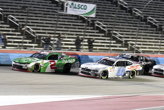 Tyler Reddick (2) and Cole Custer head into the front stretch during a NASCAR Xfinity auto race at Texas Motor Speedway in Fort Worth, Texas, Saturday, Nov. 2, 2019. (AP Photo/Randy Holt)