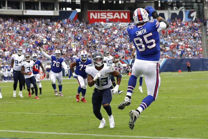 Buffalo Bills tight end Lee Smith (85) catches an 8-yard touchdown pass in front of Tennessee Titans linebacker Reggie Gilbert (93) in the first half of an NFL football game Sunday, Oct. 6, 2019, in Nashville, Tenn. (AP Photo/James Kenney)