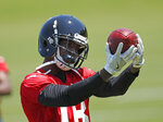 Atlanta Falcons rookie receiver Calvin Ridley warms up before start of the first NFL football practice at rookie camp Friday, May 11, 2018, in Flowery Branch, Ga. (AP Photo/John Bazemore)