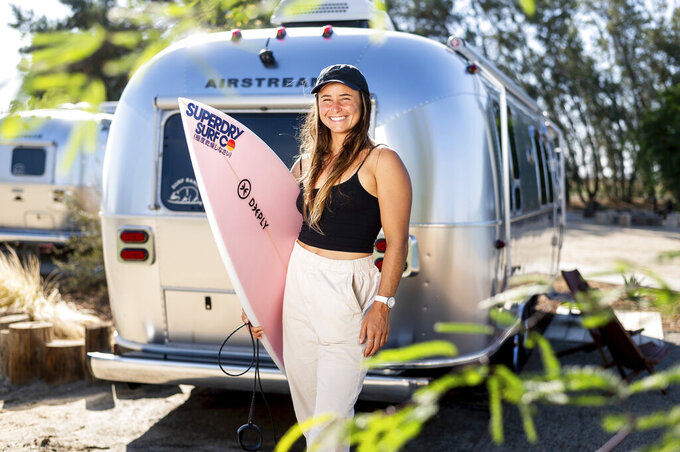 """French surfer Johanne Defay stands for a portrait during World Surf League practice sessions at Surf Ranch on Tuesday, June 15, 2021, in Lemoore, Calif. Defay wouldn't consider herself a poor surfer -- her father, after all, is a doctor, and the mega surfing brand, Roxy, started sponsoring her when she was 12, which included training opportunities in Australia and Hawaii. But the Reunion Island native recalls how devastating it was to her career when the sponsorship deal ended right before she reached the professional WSL championship tour in 2014. """"This is the sacrifice that I'm willing to do to be on the tour because it's my job, because it's my passion,"""" Defay said. """"I'm like trying to let the French surfers and the French girls know that it's possible. And maybe if we have more and more French (surfers)...then we have maybe more events there and maybe more support and maybe more sponsorship."""" (AP Photo/Noah Berger)"""