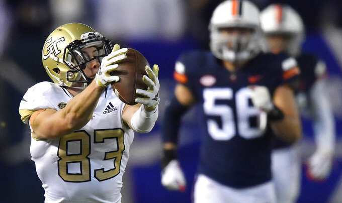 Georgia Tech wide receiver Brad Stewart (83) makes a long catch against Virginia during the second half of an NCAA football game, Saturday, Nov. 17, 2018, in Atlanta. (AP Photo/Mike Stewart)