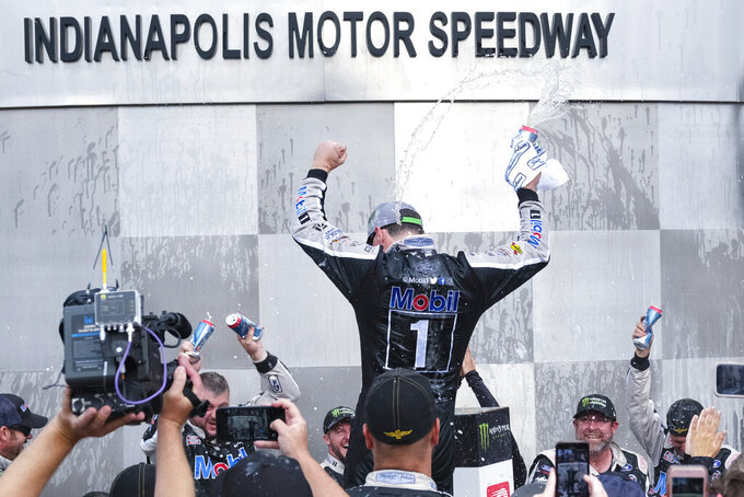 Kevin Harvick celebrates after winning the NASCAR Brickyard 400 auto race at Indianapolis Motor Speedway, Sunday, Sept. 8, 2019, in Indianapolis. (AP Photo/AJ Mast)