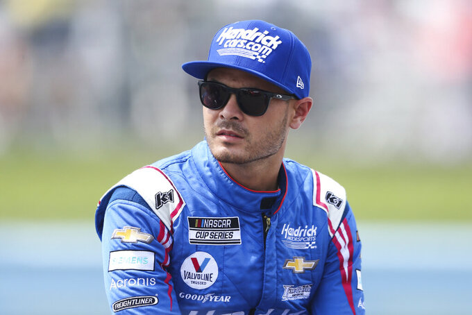 Kyle Larson sits by his car before a NASCAR Cup Series auto race in Watkins Glen, N.Y., on Sunday, Aug. 8, 2021. (AP Photo/Joshua Bessex)