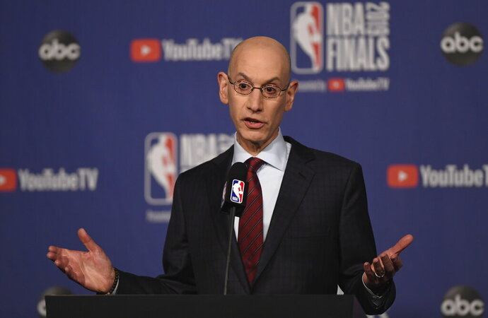 FILE - In this May 30, 2019, file photo, NBA Commissioner Adam Silver holds a news conference before Game 1 of basketball's NBA Finals between the Golden State Warriors and the Toronto Raptors in Toronto. The NBA's board of governors was unanimous Friday, Sept. 20, 2019, in its approval of a plan to stiffen potential penalties for tampering with players and employees under contract with other clubs, hoping for increased compliance in existing league rules.