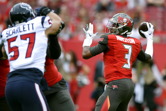 FILE - In this Dec. 21, 2019, file photo, Tampa Bay Buccaneers quarterback Jameis Winston (3) throws an interception to Houston Texans cornerback Bradley Roby during the first half of an NFL football game in Tampa, Fla. Roby ran the ball back for a touchdown. Winston led the NFL with 5,107 yards passing in 2019. He also threw for 33 touchdowns and 30 interceptions to become the first 30-30 player in league history. Opponents returned a record seven interceptions for TDs last season and scored 112 points off his league-high 35 turnovers overall. (AP Photo/Jason Behnken, File)