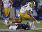 Notre Dame's Chase Claypool, top, breaks away from Northwestern's Cameron Ruiz during the second half of an NCAA college football game Saturday, Nov. 3, 2018, in Evanston, Ill. (AP Photo/Jim Young)