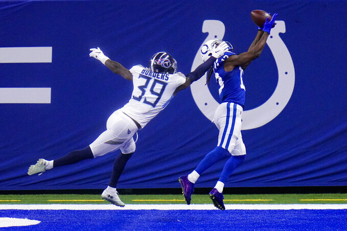 Indianapolis Colts wide receiver T.Y. Hilton (13) makes a catch for a touchdown in front of Tennessee Titans cornerback Breon Borders (39) in the second half of an NFL football game in Indianapolis, Sunday, Nov. 29, 2020. (AP Photo/AJ Mast)