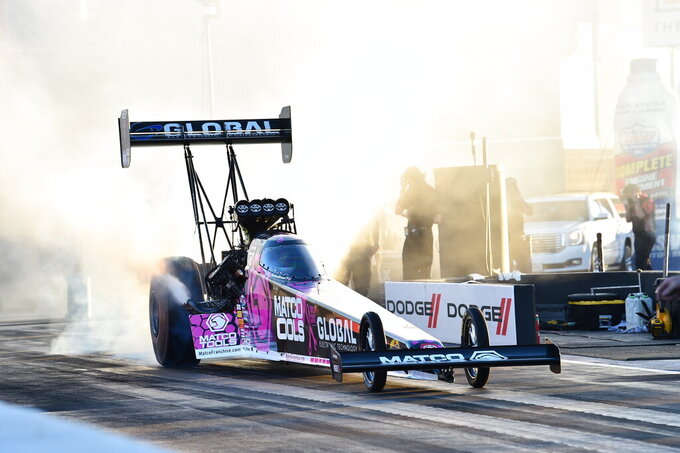 In this photo provided by the NHRA, Top Fuel's Antron Brown scored his first win since 2018 when he took down the 2020 champions Steve Torrence with his 3.740-second run at 322.19 mph to cap off the Dodge NHRA Finals presented by Pennzoil,  Sunday, Nov. 1, 2020, in Las Vegas.  (Jerry Foss/NHRA via AP)