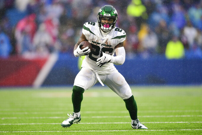 File-This Dec. 29, 2019, file photo shows New York Jets running back Le'Veon Bell (26) during the first half of an NFL football game against the Buffalo Bills in Orchard Park, N.Y.  The New York Jets have surprisingly released Bell, ending a disappointing tenure after less than two full seasons. The team issued a statement from general manager Joe Douglas on Tuesday, Oct. 13, 2020, in which he says the Jets made the move after having several conversations with Bell and his agent during the last few days and exploring trade options. (AP Photo/David Dermer, File)