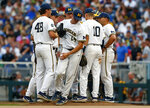 Michigan pitcher Benjamin Keizer (14) is pulled in the sixth inning against Vanderbilt in Game 2 of the NCAA College World Series baseball finals in Omaha, Neb., Tuesday, June 25, 2019. Vanderbilt won 4-1 to tie the series at one apiece. (AP Photo/John Peterson)