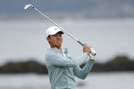 Amateur player Brandon Wu watches his tee shot on the 18th hole during the second round of the U.S. Open golf tournament Friday, June 14, 2019, in Pebble Beach, Calif. (AP Photo/Matt York)