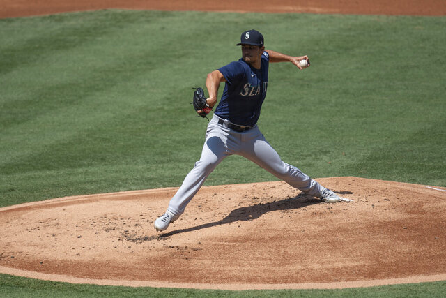 Seattle Mariners starting pitcher Marco Gonzales delivers during the first inning of a baseball game against the Los Angeles Angels in Anaheim, Calif., Monday, Aug. 31, 2020. (AP Photo/Kyusung Gong)