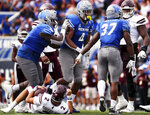 Memphis defensive lineman Maurice White (4) celebrates with teammates after sacking Mississippi State quarterback Will Rogers III (2) during an NCAA college football game Saturday, Sept. 18, 2021, in Memphis, Tenn. (Patrick Lantrip/Daily Memphian via AP)