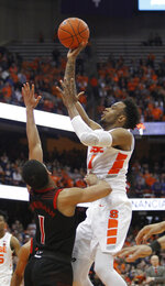 Syracuse's Oshae Brissett, right, shoots over Louisville's Christian Cunningham, left, during the second half of an NCAA college basketball game in Syracuse, N.Y., Wednesday, Feb. 20, 2019. Syracuse won 69-49. (AP Photo/Nick Lisi)