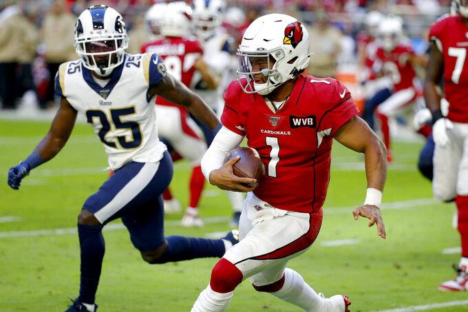Arizona Cardinals quarterback Kyler Murray scrambles against the Los Angeles Rams during the first half of an NFL football game, Sunday, Dec. 1, 2019, in Glendale, Ariz. (AP Photo/Rick Scuteri)