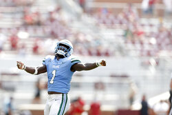 Tulane linebacker Nick Anderson (1) celebrates after his team recovered an onside kick late in the fourth quarter of an NCAA college football game against Oklahoma in Norman, Okla. on Saturday, Sept. 4, 2021. (Ian Maule/Tulsa World via AP)